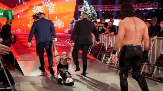 AOP drag Rey Mysterio up the ramp with Seth Rollins following