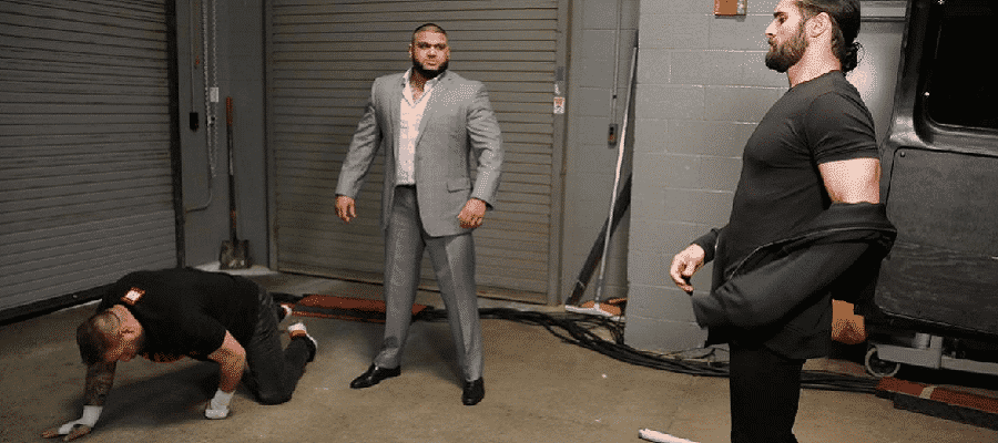 Seth Rollins and one of AOP with Kevin Owens on the ground