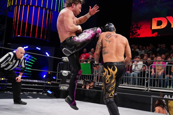 Kenny Omega plants Rey Fenix with a high knee