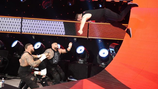 Kevin Owens dives off the curved backdrop onto AOP and Samoa Joe