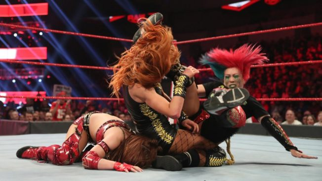 Asuka attacks Becky Lynch after Lynch pins Kairi Sane